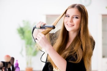 women straightening hair with babyliss pro