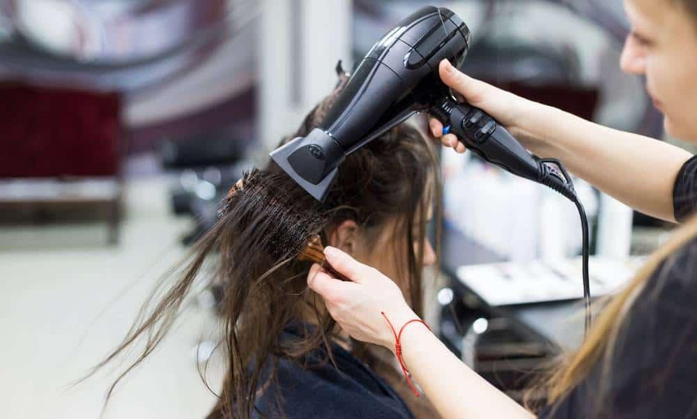 Woman in a hair salon, blow drying hair